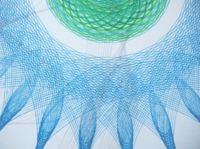 Detail of blue Copic Multiliner Sky blue and green pencil color and Pigma Micron Green marker ink.  Pencil figure behind them shows a bit.