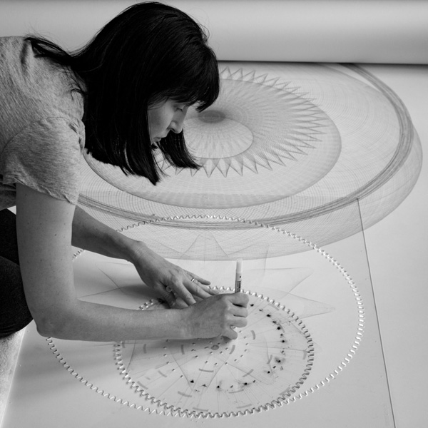 Mary Wagner drawing a large figure with her drawing machine.