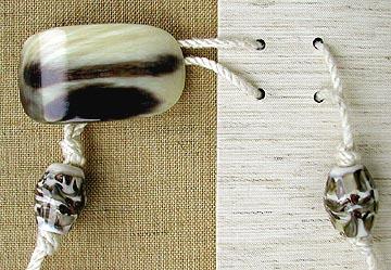 Decorative binding with polished bone closure.