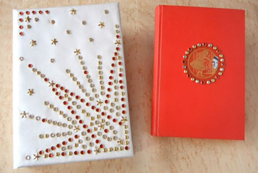 Red leather binding with clam-shell book box.