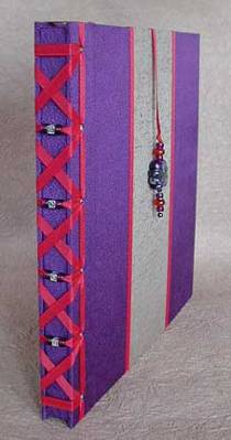 Decorative binding for a wedding album.
