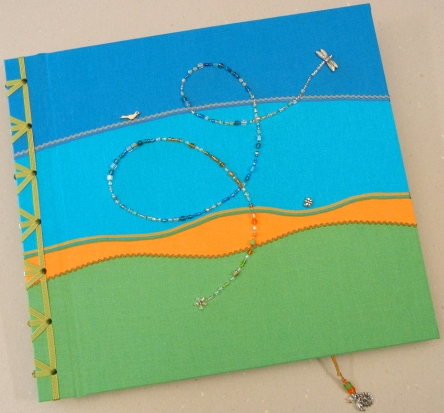 Decorative bookbinding for a baby book.